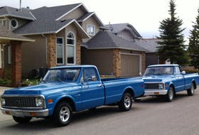 Chuck's trucks: the original bodied 1971 Chevrolet C10 in front, with chrome bumpers, and the 1972 C10 at back, with white bumpers. Chuck Young Photo