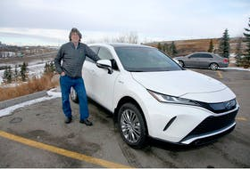 Brian Byl with the 2021 Toyota Venza Limited he drove around Calgary for a week. Brendan Miller/Postmedia