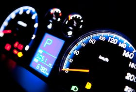 Close-up view of speedometers and other gauges on a passenger car. 123rf stock photo