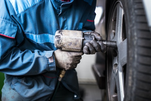 It's quite possible you may need to pay for tire re-balancing if you experience vibration after the shop has rotated your tires. 123rf stock photo