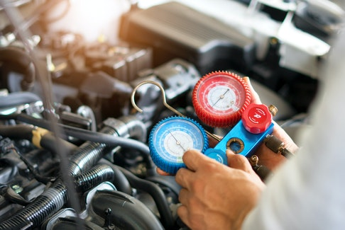 Recharging your car's air-conditioning system is best left to the professionals. 123rf stock photo