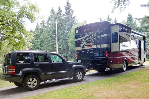A motorhome with a 'dinghy-towed' Jeep. RV Lifestyle photo