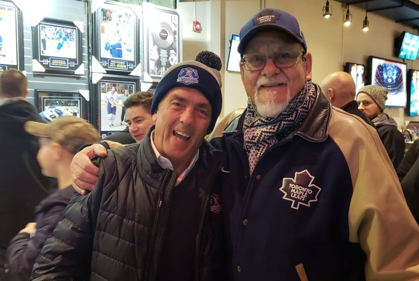 Rolf Bjordammen (right) with Ultimate Leaf Fan Mike Wilson at Scotiabank last season. Wilson is writing a book on attending every Leafs game in 2018-19, called The Ultimate Road Trip.