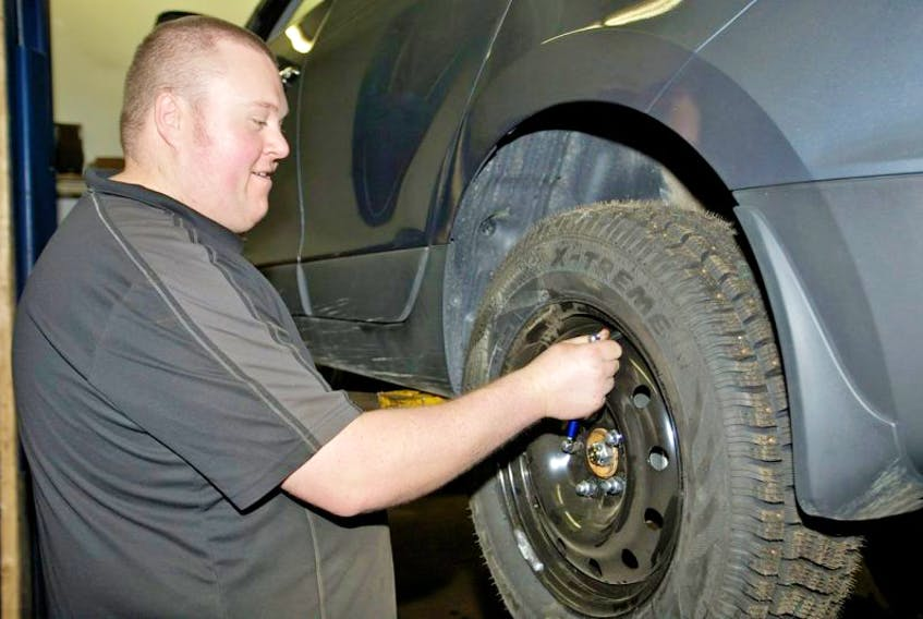 The rush is on at Digby area garages to switch over to snow tires. Tightening the wheel nuts on a new tire is Steven Spurr of Boliver's Service Centre.