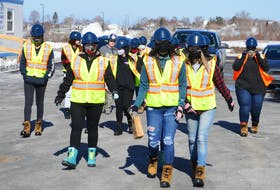 Participants in the Women Unlimited's Career Exploration Program make their way toward the Membertou Place job site for a tour of the work going on at the three-storey, 55,000 square-foot office building currently under construction. DAVID JALA/CAPE BRETON POST