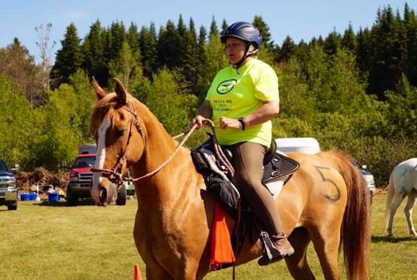 Donna Lee, president of the P.E.I. Trail Riders, rides her horse, Bohannon.