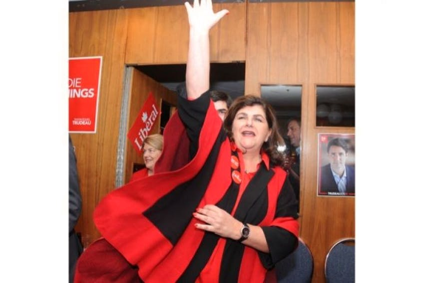 A victorious Long Range Mountains candidate Gudie Hutchings enters her headquarters at the Glynmill Inn Monday.