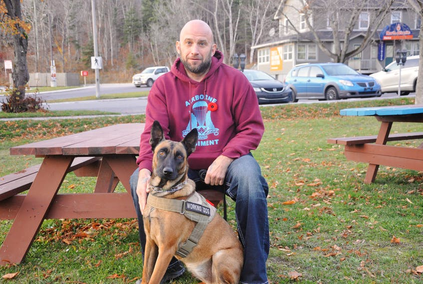 Mike Rude and his service dog, Spark. Rude says he was recently told he couldn't be in the Valley Mall in Corner Brook with Spark.