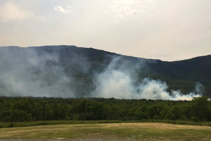 Smoke rises from the burning woods near Blow-Me-Down Brook after a forest fire erupted there Wednesday.