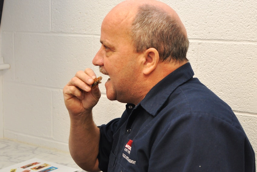 Dan Quilty gave grilled eel a try during a taste testing at Grenfell Campus's Functional Foods Laboratory in Corner Brook on Wednesday.