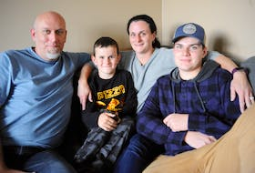 Tracy and Mark Vaters of Corner Brook, posing here for a photo with their sons, six-year-old Kyle Vaters and 14-year-old Mitchell Prosper, will be doing their seventh Red Shoe Crew Walk for Families in Irishtown-Summerside this weekend.