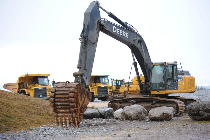 Heavy equipment — including two excavators, two dump trucks, a grader and a bulldozer — was staged at the site of the new Western Memorial Regional Hospital in Corner Brook Monday.