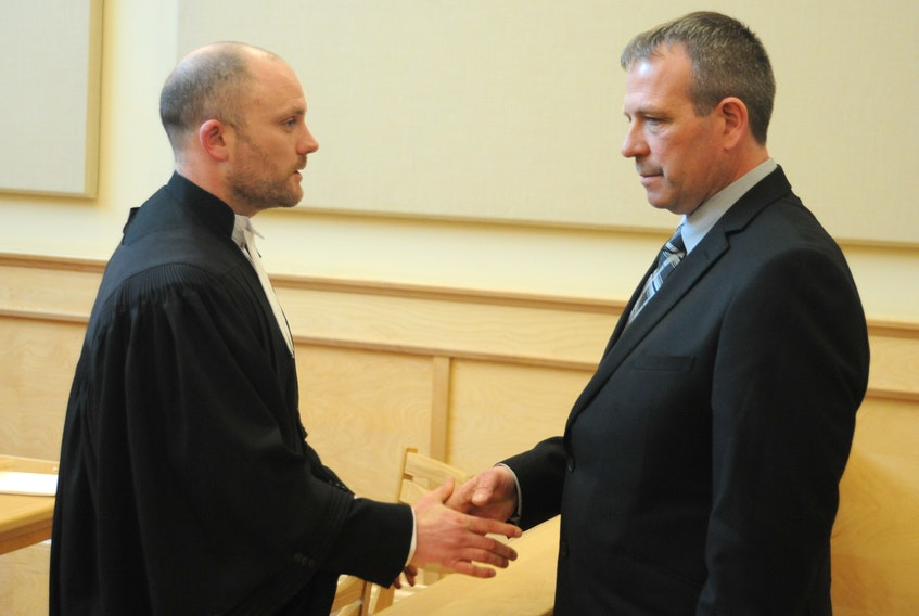 Walter Alfred Joyce, right, shakes the hand of his lawyer, Robby Ash, after a hearing Tuesday into whether or not Joyce's charter rights were violated the night he was arrested for impaired driving causing death in December 2016.