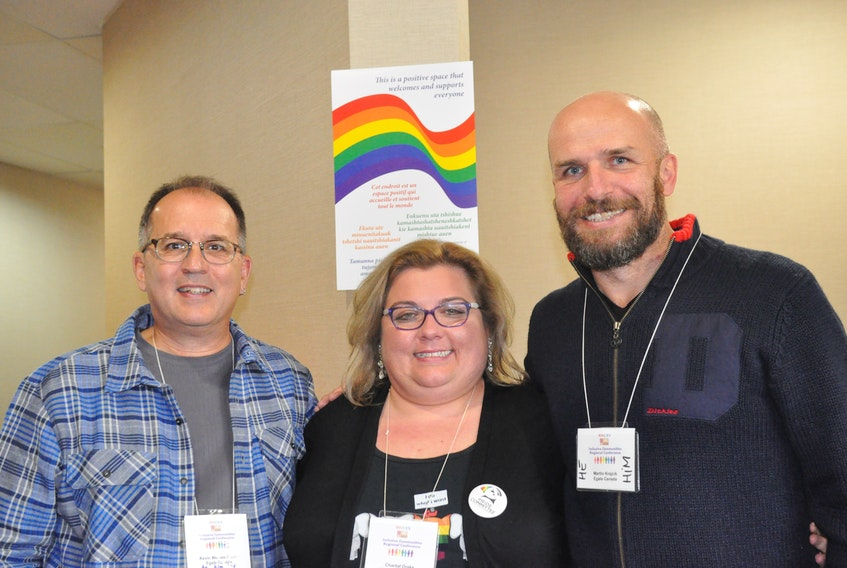Chantal Drake, centre, one of the participants in an Inclusive Communities Regional Conference, poses for a photo with facilitators Kevin Welbes Godin, left, and Martin Krajcik.