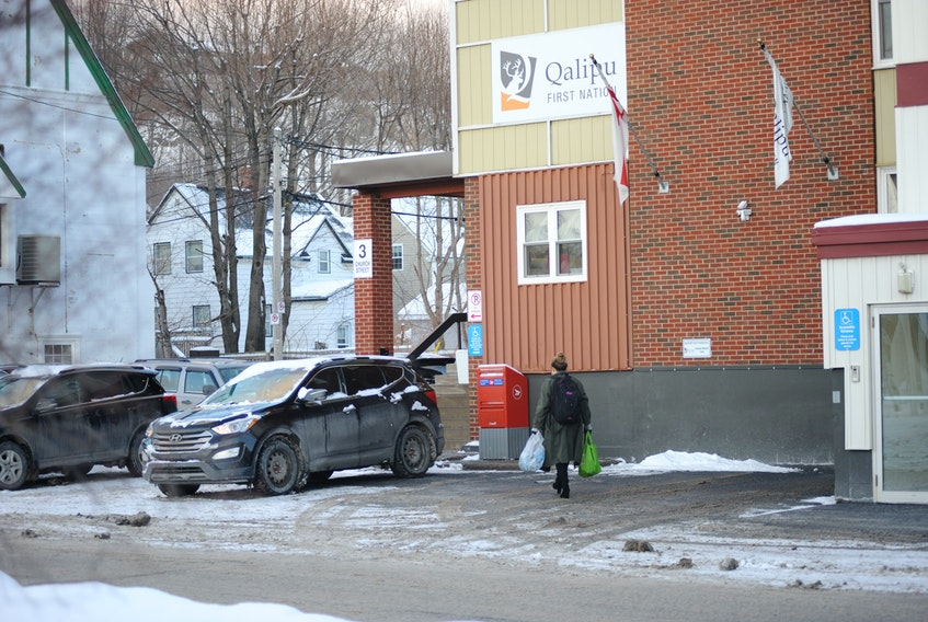 Staff leave work for the day at the Qalipu Mi'kmaq First Nation Band office in Corner Brook Thursday. Earlier this week, the band and the federal government began talks concerning how to reassess thousands of people denied band membership.