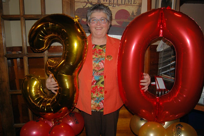Debbie Wilton, a former client of the CBDC Long Range who is now a member of the board, poses for a photo as she helped the organization celebrate its 30th anniversary on Wednesday.