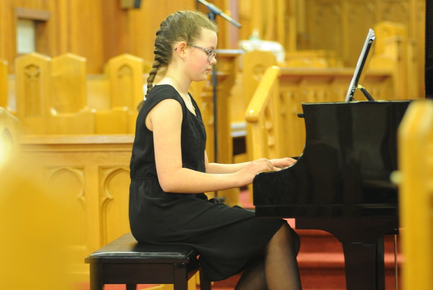 """Alyssa Wentzell plays """"Atacama Desert"""" by composer Wynn-Anne Rossi for her performance in the Piano Level 2 (not over 12 years old) Romantic, Modern and Inventions category at St. John the Evangelist Church during the Rotary Music Festival in Corner Brook Wednesday afternoon. The festival continues at multiple venues until the final concert and awards Tuesday."""