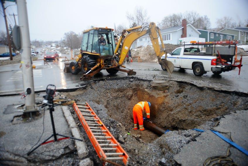 Corner Brook work crews dealt with this washout on Elizabeth Street much of Saturday.