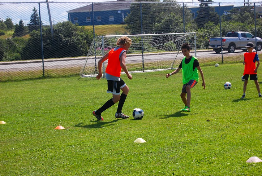 Clay King, left, of Stephenville Minor Soccer does some footwork as he attempts to get past Liam McIsaac with the ball during a practice drill at Mayfield Pitch in Stephenville in this file photo involving Under-12 and Under-14 boys' players. Seth Alexander is at the right.