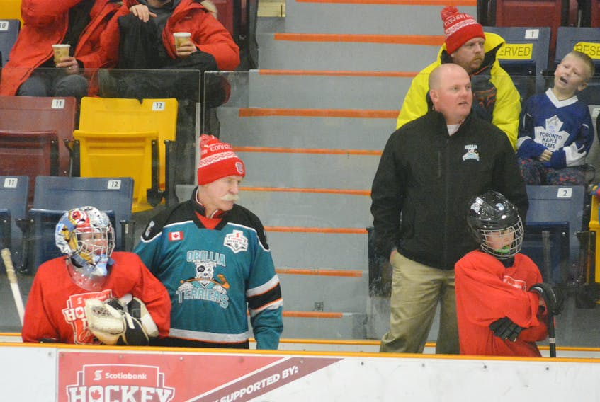 NHL legend Lanny McDonald wears a Orillia Terrier jersey while coaching the Terriers during the Heroes of Hockey Day game in Corner Brook Saturday.