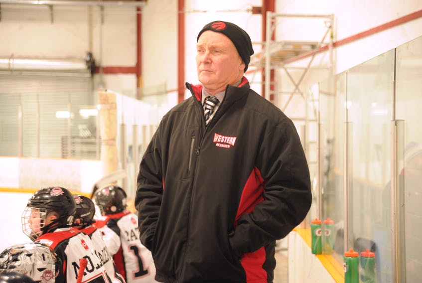 Coach Gerard Morry keeps an eye on the action during a Western Kings game against the TriPen Ice in provincial AAA peewee hockey league play last weekend at the Corner Brook Civic Centre.