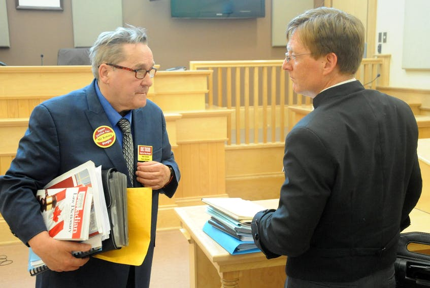 Eric Tucker, left, speaks with Jamie Merrigan, lawyer for the Federation of Newfoundland Indians and the Qalipu Mi'kmaq First Nation Band, following Tucker's failed attempt to have the Supreme Court of Newfoundland and Labrador declare Merrigan to be in a conflict of interest for representing both entities.
