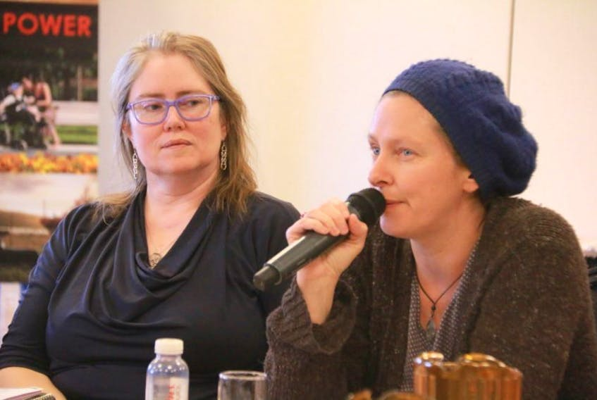 Paula Sheppard-Thibeau (left) and Tanya McFadyen, both with Corner Brook Status of Women's council, share their concerns and ideas about the proposed Individual Funding community supports at a workshop put on by Newfoundland and Labrador Association for community Living in Deer Lake on Monday.