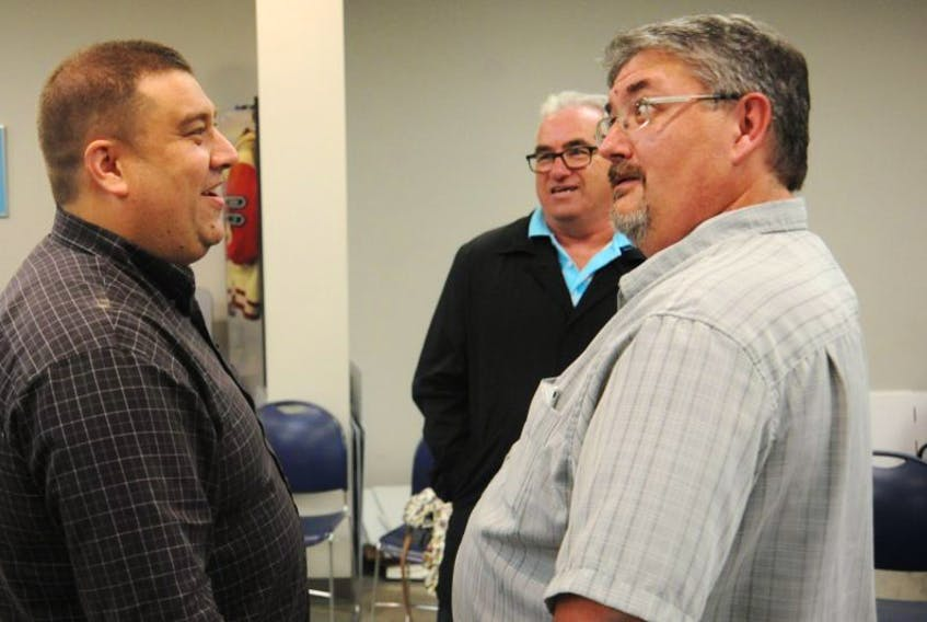 Corner Brook's mayor-elect Jim Parsons, left, chats with Lenny Benoit, who fell just 39 votes shy of being elected to city council in Tuesday's election. Looking on is Bill Griffin, who earned the most votes for city councillor.