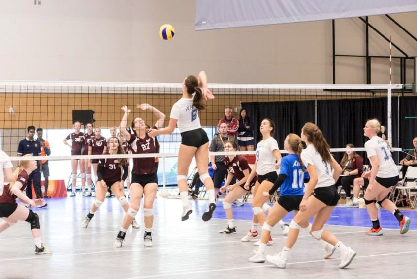 Hailey Oke of Team Newfoundland and Labrador (No. 27) tries to defend against Team Alberta during a female volleyball match at the 2017 Canada Summer Games in Winnipeg.