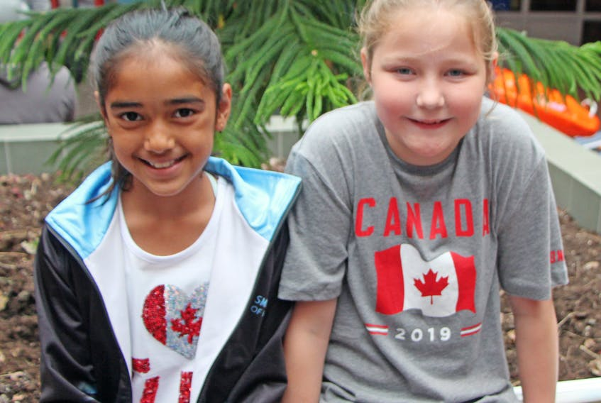 Yashita Ghore (left) and Emma Young recently hosted a yard sale in support of sea turtles. They raised more than $465, which will go to seaturtle.org – an international organization focussed on the preservation of the species. Corey LeBlanc