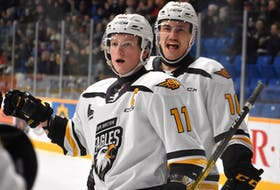Derek Gentile of the Cape Breton Eagles, right, and teammate Shawn Element celebrate on a goal during the team's final home game of the 2019-20 season against the Quebec Remparts on March 4, 2020. The QMJHL season was cancelled a week later due to the COVID-19 pandemic. JEREMY FRASER/CAPE BRETON POST.