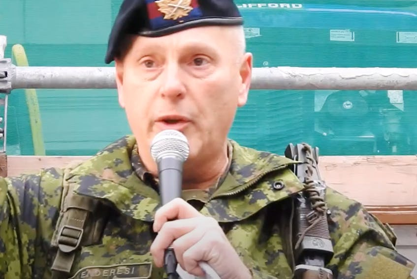 A Canadian Forces member, introduced by organizers of an anti-lockdown rally as Leslie Kenderesi speaks at the gathering in Toronto. (Screenshot from YouTube video)
