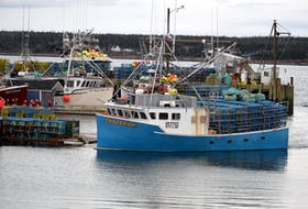 A lobster fishing boat steams back to its berth at the Dennis Point wharf in Lower West Pubnico  with a load of lobster traps aboard to wait for the 2020-2021 season opening in LFA 34. KATHY JOHNSON PHOTO