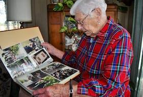 Betty Lovitt looks through an album of photographs taken over the years at reunions of the West Nova Scotia Regiment. Lovitt is a World War II war bride. KATHY JOHNSON PHOTO