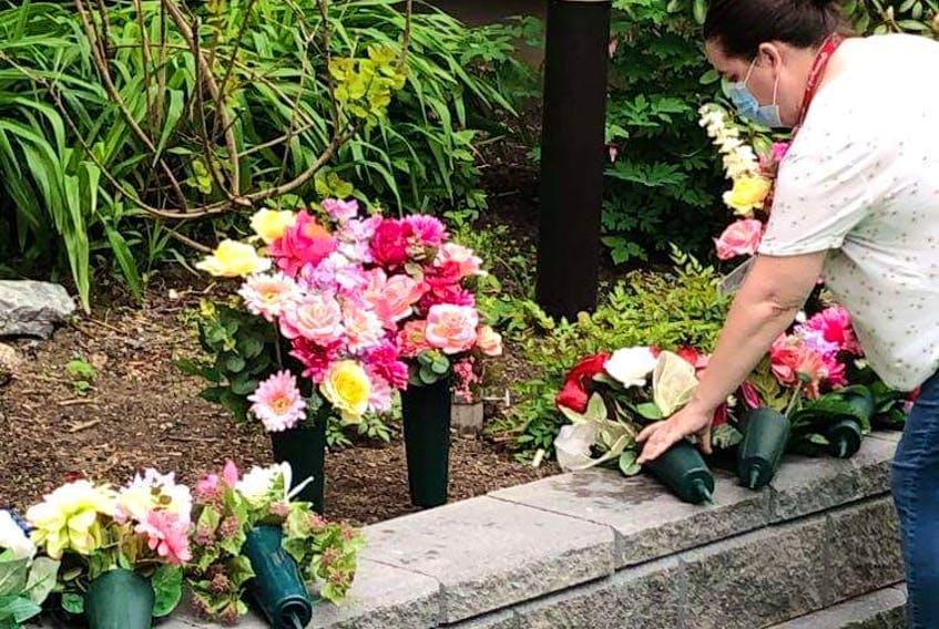 Memorial bouquets for Nova Scotia's 62 victims of COVID-19 (as of June 15) are placed in the courtyard at the Northwood long term care facility in Halifax. The bouquets were made by Elizabeth and Geoff Riddell, Shelburne. Contributed.
