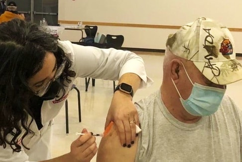 Shelburne pharmacist Colleen MacInnis delivers the COVID-19 vaccine to a patient at the prototype vaccination clinic in Shelburne. The three-day clinic for people 80 and over was held at the Shelburne Community Centre.