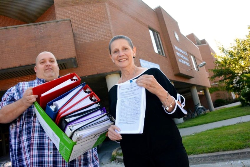Yarmouth residents Derek Lesser and Sandy Dennis carry a petition containing more than 13,350 signatures into a meeting years ago with Nova Scotia Health Minister Randy Delorey at the Yarmouth Regional Hospital. The grassroots group Western Nova Scotia Cancer Support Network was pushing for cancer radiation services to be available at the Yarmouth Regional Hospital to serve western Nova Scotia. - Tina Comeau