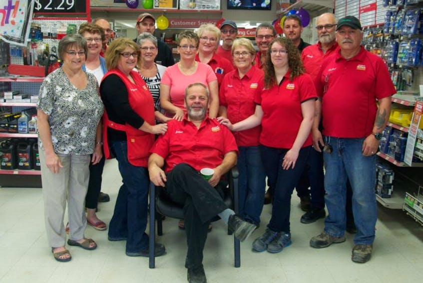 Arthur Thompson sits in front of the staff at the Sissiboo Home Hardware in Weymouth, the store he's worked at for 27 years.