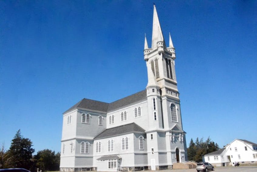 Église Ste-Marie in Church Point, Digby County. The church measures 185 feet in height from the ground to the steeple. It also measures 190 feet in length and inside, 63 feet in height from the floor to the ceiling.