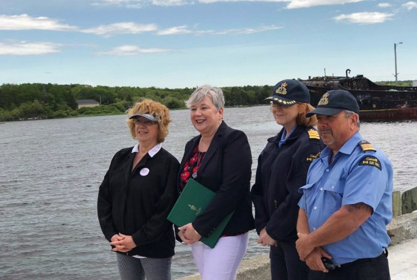 Mayor Karen Mattatall, MP Bernadette Jordan, Anne Miller Canadian Coast Guard and Keith Laidlaw Canadian Coast Guard pose on the government wharf on June 15 where the Farley Mowat currently is berthed.